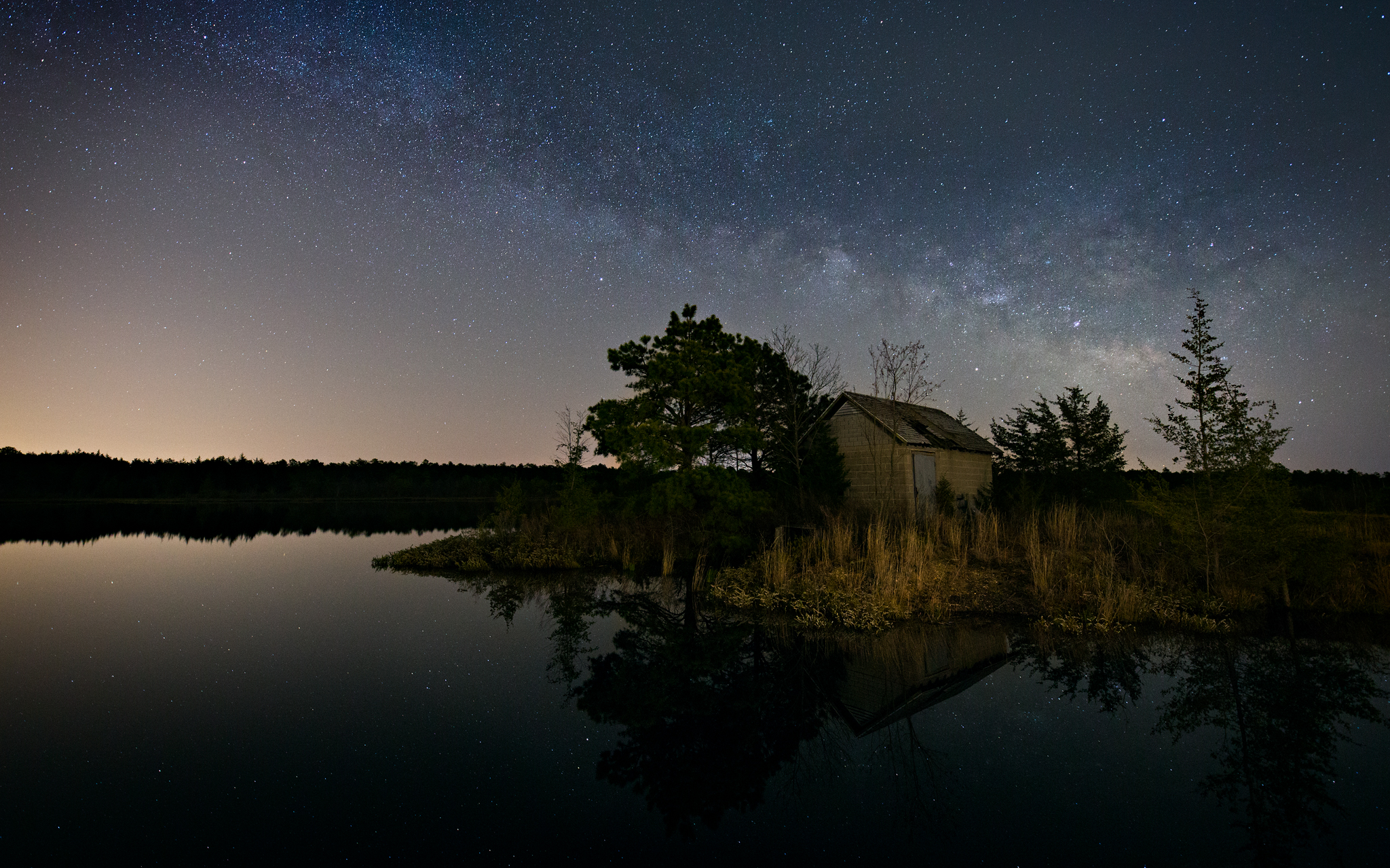 The arm of the Milky Way rises over an old cranberry bog in Franklin Parker Preserve.